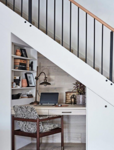 Space between the stairs turned into an office